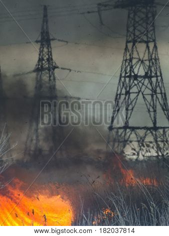 The fire in the field near high-voltage poles
