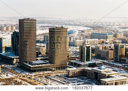 Ministry of Defense of the Republic of Kazakhstan and two towers of Talan Towers on a sunny day in Astana, Kazakhstan.