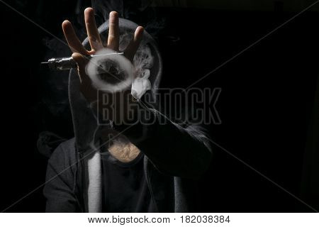 Circle Tricks Of Smoke Vaping By A Young Man.