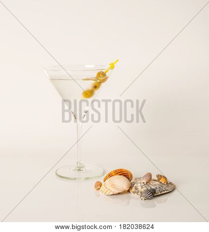 Drink In Martini Glass, Martini Drink With Green Olives, Seashells