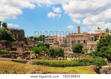 Rome Italy - June 25 2015: People sightseeing in the iconic landmark Roman Forum in Rome Italy