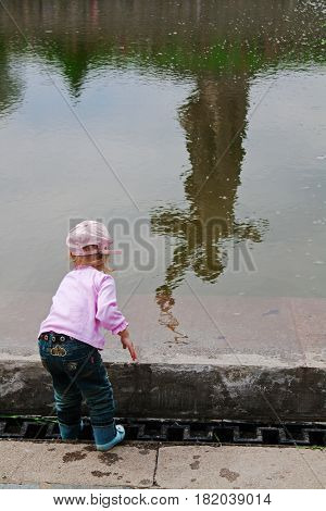 Volgograd Russia - May 9 2010: Little girl on the background of reflection of monument