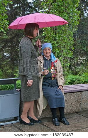 Volgograd Russia - May 09 2011: World War II veteran accompanied by relative on Victory Day celebration in Volgograd