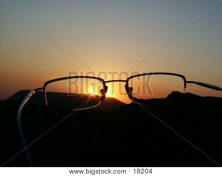 Sihoutte Of A Reading Glass At Sunset