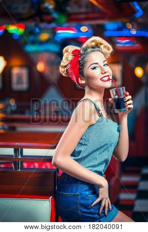 Young pin-up girl indoors