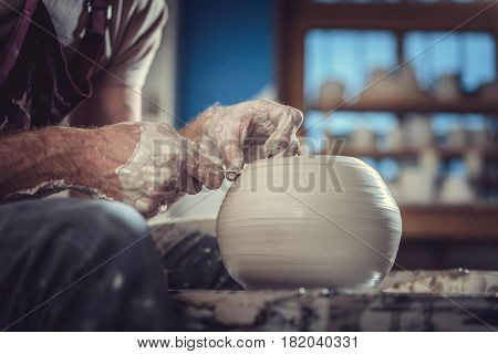 Worker making a ceramic vase