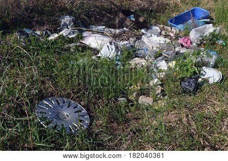Ukrainian nature at spring.Environmental contamination. Illegal junk dump.  April 17, 2017.Near Kiev, Ukraine