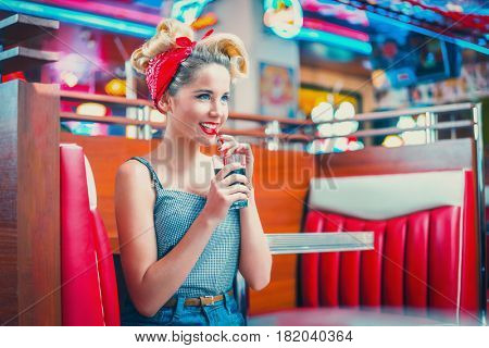 Beautiful young woman in retro cafe