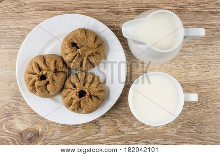 Pies Stuffed From Unleavened Dough In Plate, Jug And Milk