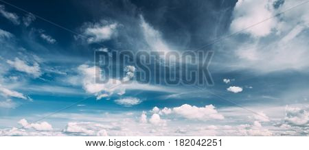 Panorama Of Bright Blue Sky With White Fluffy Clouds. Cloudy Sky. Blue Sunny Cloudscape Background