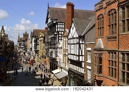 Chester England UK Europe - May 26 2014 : Tourists on Eastgate street in Chester City centre