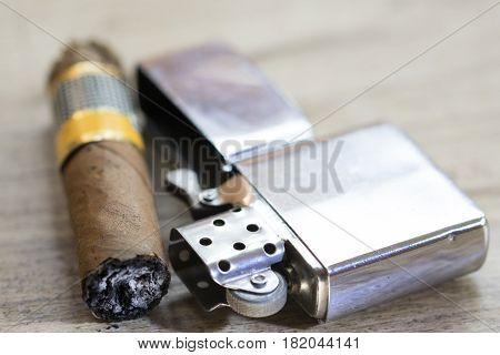 Havana cigar just smoked and petrol metallic lighter