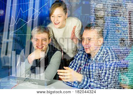 Three people are happy after they have done the work