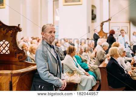 Vilnius, Lithuania - July 6, 2016: Man praying in Cathedral Basilica of Saints Stanislaus and Vladislaus during celebration of Statehood Day. Holiday in commemorate coronation in 1253 of Mindaugas King.