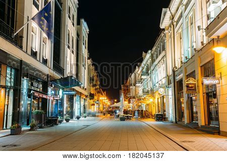 Vilnius, Lithuania - July 8, 2016:  View Of Vilniaus Street In Night Under Summer Black Sky. The Old Architecture And Bright Illumination Of Modern Cafes And Restaurants In Popular Touristic Showplace.