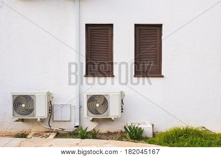 Air conditioner compressor installed on a building.