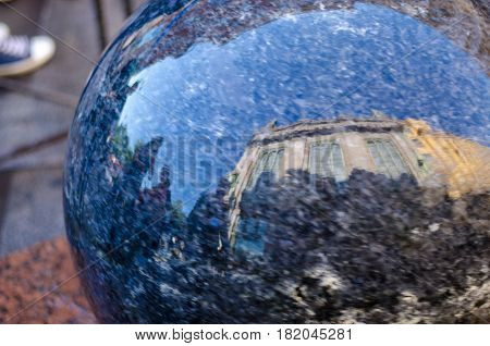 Stone sphere reflected in water in Saint Petersburg, Russia