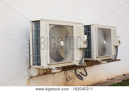 Air conditioning compressor. Air conditioner compressor installed on a building.