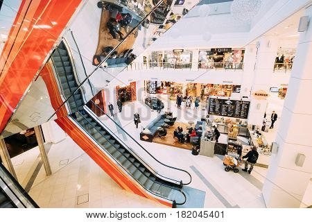 Tallinn, Estonia - December 2, 2016: People resting and walking at the modern shopping mall Kristiine Shopping Centre