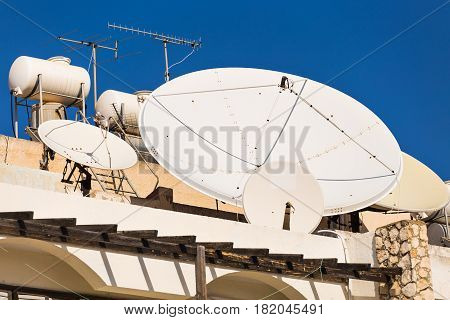 Satellite dish with sky on the roof