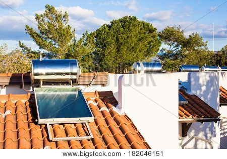 Solar heater for green energy. Contemporary hot water panels on a house