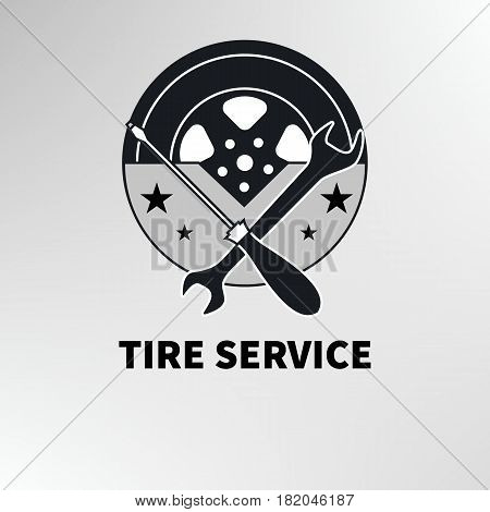 Black and white icon logo tire service. Monochrome flat wheel and tools - spanner and screwdriver in retro style. Vector illustration.