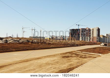 Construction of multi-storey apartment buildings on the outskirts of the city.