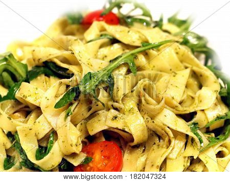 Delicious Italian pasta with vegetables photographed in close-up