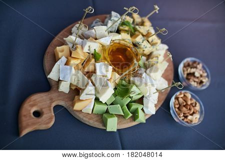 cheese platter, Assorted with nuts and honey on a plate