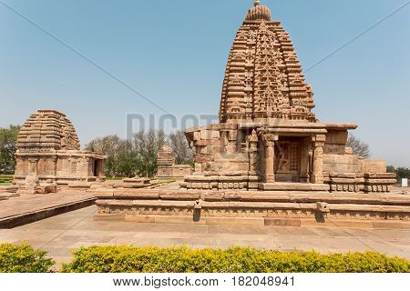 Stone gopuram towers of Hindu temples architecture landmark in Pattadakal, India. UNESCO World Heritage site with stone carved temples of 7th and 8th-century