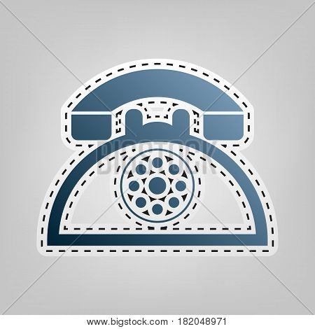 Retro telephone sign. Vector. Blue icon with outline for cutting out at gray background.
