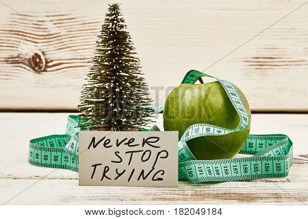 Fir-tre, motivation card and apple. Mistakes are proof of try.
