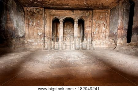 Light inside the historical hall of 6th century cave Hindu temples architecture landmark in Aihole, India.