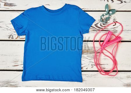 T-shirt, skipping rope and scrunchy. Sport and beauty.