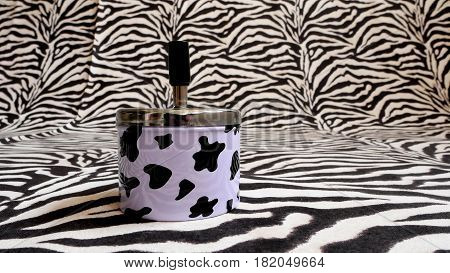 Ashtray with zebra drawings and zebra background