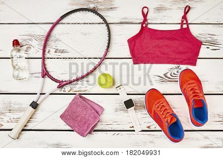 Towel, badminton racket and watch. Overcome your laziness.