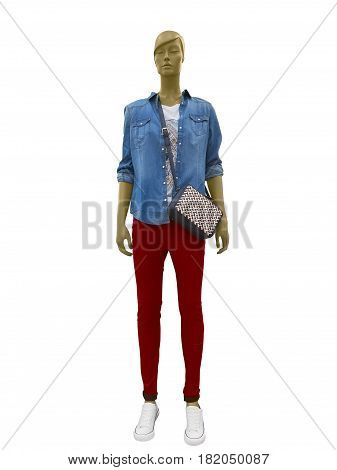 Full-length female mannequin dressed in blue shirt and red trousers. Isolated on white background. No brand names or copyright objects.