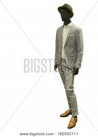 Full length male mannequin dressed in suit and hat isolated on white background. No brand names or copyright objects.