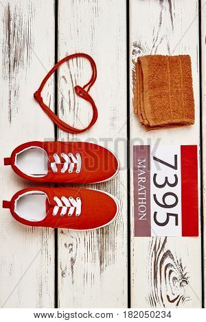 Towel, number, keds and shoelaces. Sport is my fuel.