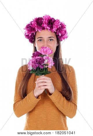 Beautiful teenager girl with purple flowers in her head and a bouquet isolated on a white background
