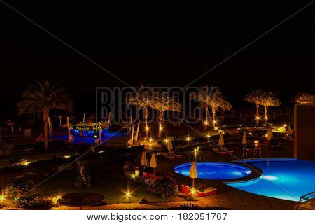 Sharm El Sheikh, Egypt - April 7, 2017: Evening view of swimming pool at luxury hotel Barcelo Tiran Sharm 5 stars at night at Sharm El Sheikh, Egypt on April 7, 2017