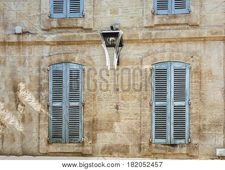 The facade of an old apartment building in the historic center of Avignon in France