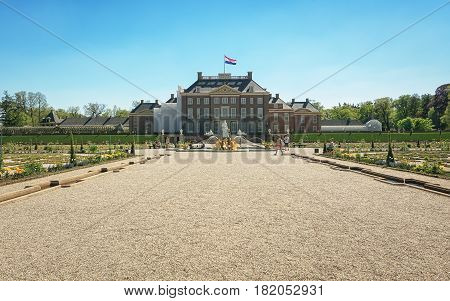 Apeldoorn, The Netherlands - May 8, 2016: Dutch baroque garden of The Loo Palace a former royal palace and now a national museum located in the outskirts of Apeldoorn in the Netherlands