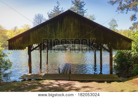 Boathouse with jetty in the lake of Het Loo park located in Apeldoorn in The Netherlands