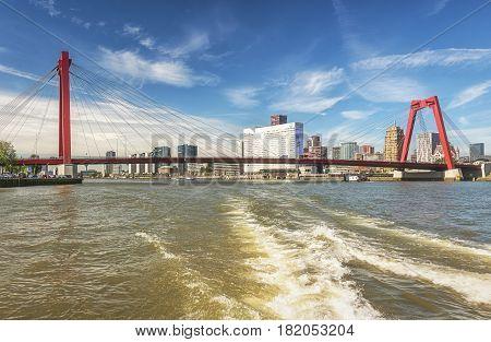 Rotterdam, Netherlands - August 18 2016: The bridge Willemsbrug spans the river Nieuwe Maas and is 356 meters long.