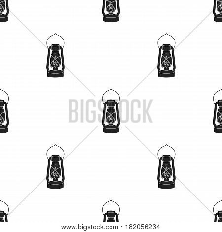 Kerosene lamp icon in black style isolated on white background. Light source pattern vector illustration