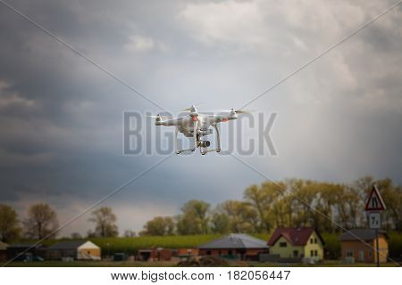 Drone Flying Over A Field Next To The Village And Shooting Spring Nature