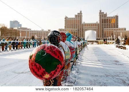 Astana, Kazakhstan - February, 2017 - Expo-men, symbolizing the countries-participants of EXPO-2017, against the backdrop of the office of KazMunaiGas in Astana, Kazakhstan