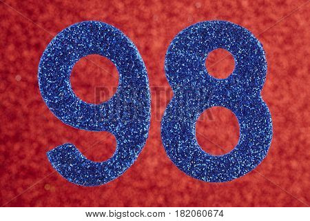 Number ninety-eight blue color over a red background. Anniversary. Horizontal