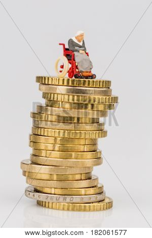 woman in wheelchair on money stack